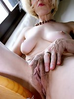 Old mature provides scenes of her shaved pussy