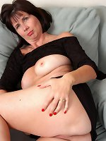 Blonde milf touches her shaved vag while teasing